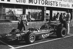 The March 701-Ford of Chris Amon sits in the pit lane
