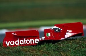 The Ferrari front wing of Michael Schumacher, lies by the side of the track