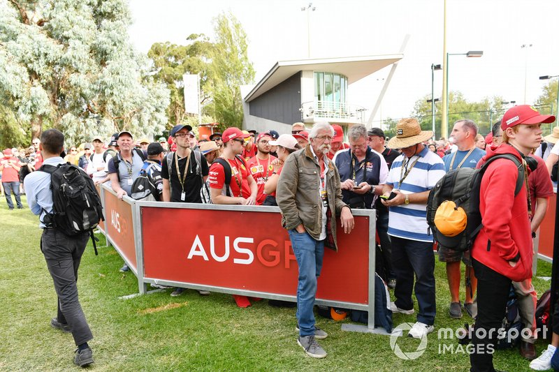 Fans wait outside the circuit as the gates are delayed in opening