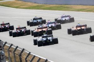 Max Verstappen, Red Bull Racing RB16, leads Valtteri Bottas, Mercedes F1 W11 EQ Performance, Alex Albon, Red Bull Racing RB16, Lance Stroll, Racing Point RP20, Sergio Perez, Racing Point RP20, Carlos Sainz Jr., McLaren MCL35, Pierre Gasly, AlphaTauri AT01, and Lando Norris, McLaren MCL35, at the start