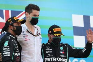 Lewis Hamilton, Mercedes-AMG Petronas F1, 1st position, Valtteri Bottas, Mercedes-AMG Petronas F1, 3rd position, with their team mate on the podium