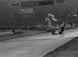 Jacky Ickx, Ferrari 312B, takes the flag to win