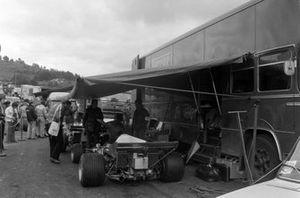 Mecahnics with Jacky Ickx's Ferrari 312B2 in the paddock