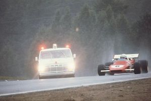 Mario Andretti, Ferrari 312B2 passes an ambulance going to the aid of his teammate Clay Regazzoni, Ferrari who had crashed