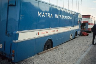 Matra team transporter dug into the gravel in the paddock