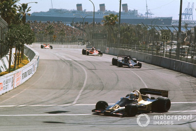 With the Queen Mary forming a unique backdrop, Jody Scheckter's Wolf leads the Lotus of eventual winner Mario Andretti and Niki Lauda's Ferrari in 1977.