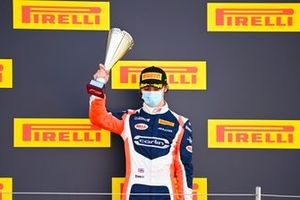 Clement Novalak, Carlin celebrates on the podium with the trophy