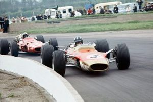Graham Hill, Lotus 49B-Ford, leads Chris Amon, Ferrari 312