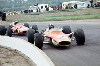 Graham Hill, Lotus 49B-Ford, leads Chris Amon, Ferrari 312