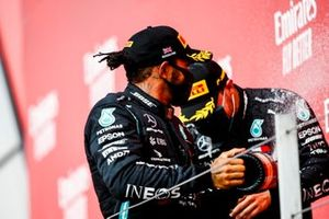 Lewis Hamilton, Mercedes AMG F1, and Max Verstappen, Red Bull Racing, celebrate on the podium