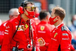 Sebastian Vettel, Ferrari, talks to his engineer on the grid