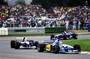 Michael Schumacher, Benetton B195 Renault, leads David Coulthard, Williams FW17 Renault