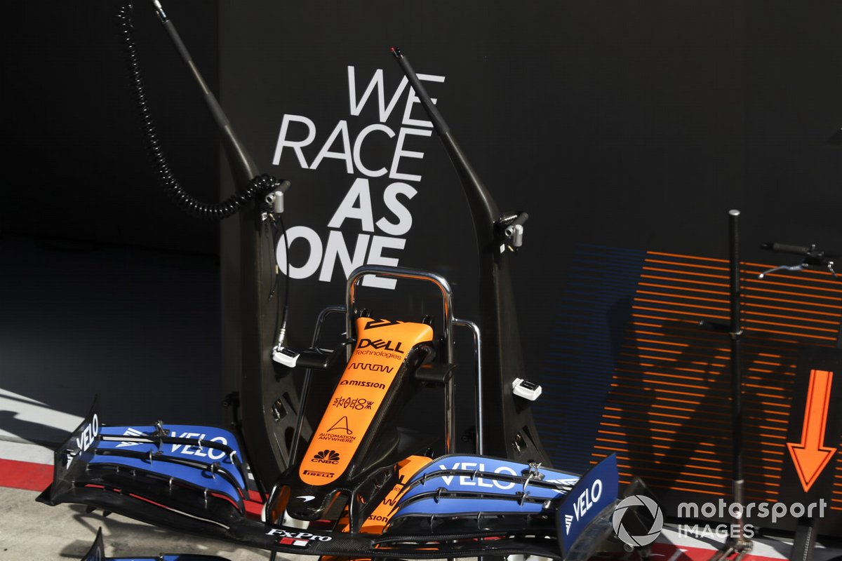 Front wing of MCL35 infront of We Race As One logo