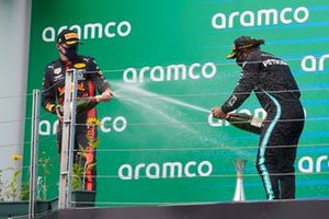 Max Verstappen, Red Bull Racing, and Lewis Hamilton, Mercedes-AMG Petronas F1 on the podium