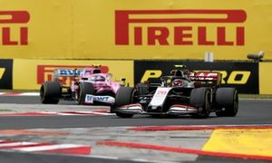 Kevin Magnussen, Haas VF-20 and Lance Stroll, Racing Point RP20