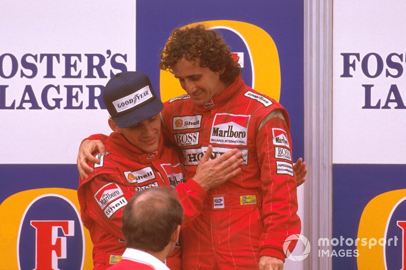 Podium: race winner Ayrton Senna, McLaren congratulates second place Alain Prost, McLaren with Ron Dennis looking on