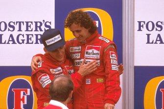 Podium: race winner Ayrton Senna, McLaren congratulates second place Alain Prost, McLaren with Ron Dennis looking on