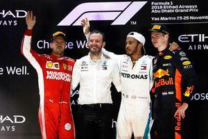 Sebastian Vettel, Ferrari, 2nd position, Bradley Lord, Communications Director, Mercedes, Lewis Hamilton, Mercedes AMG F1, 1st position, and Max Verstappen, Red Bull Racing, 3rd position, on the podium