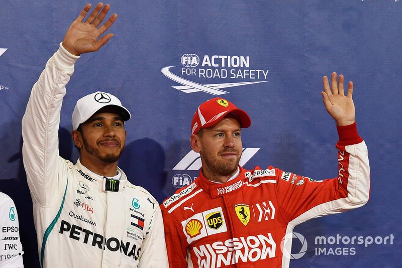Ganador de la poe Lewis Hamilton, Mercedes AMG F1, y el tercer puesto Sebastian Vettel