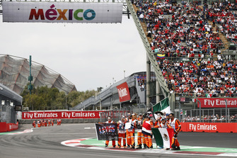 Marshals with Mexican flags ahead of the race