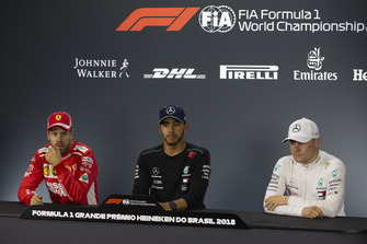(L to R): Sebastian Vettel, Ferrari, Lewis Hamilton, Mercedes AMG F1 and Valtteri Bottas, Mercedes AMG F1 in the press conference