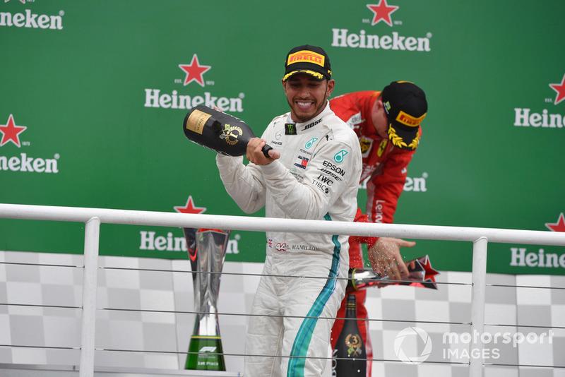 Lewis Hamilton, Mercedes AMG F1 celebrates on the podium with the champagne