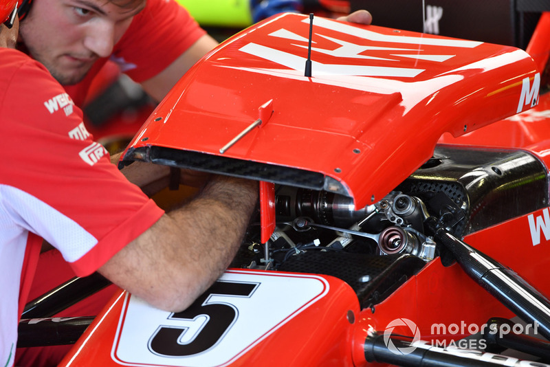 Ferrari mechanics adjust Ferrari SF-71H front suspension