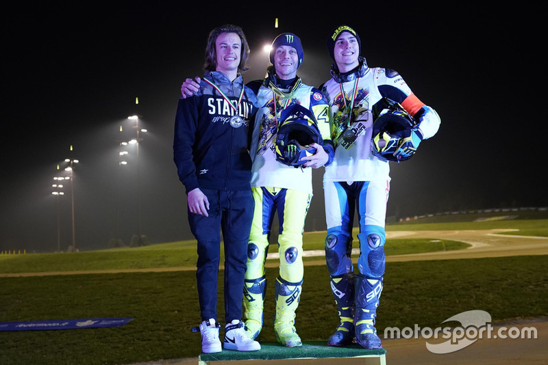 Valentino Rossi celebrating his victory with Nicolo Bulega and Lorenzo Baldassarri