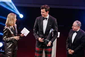 Toto Wolff receives a John Bolster Award on stage with Nicki Shields and FIA President Jean Todt