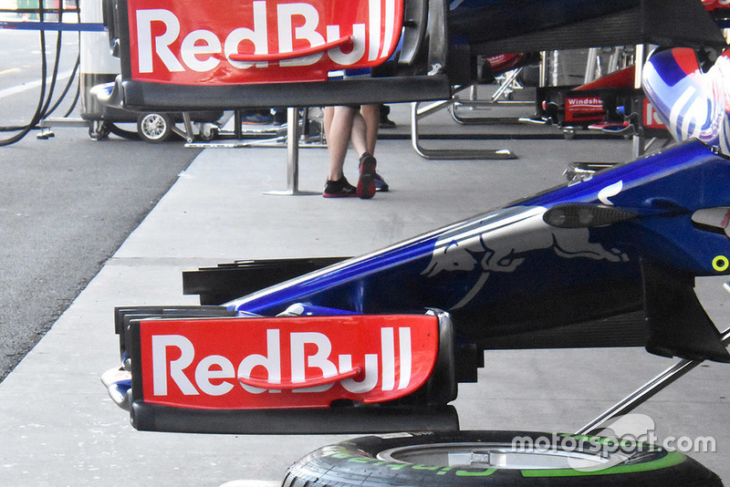For comparison, the older specification front wing endplate on the STR13 that extends further back.