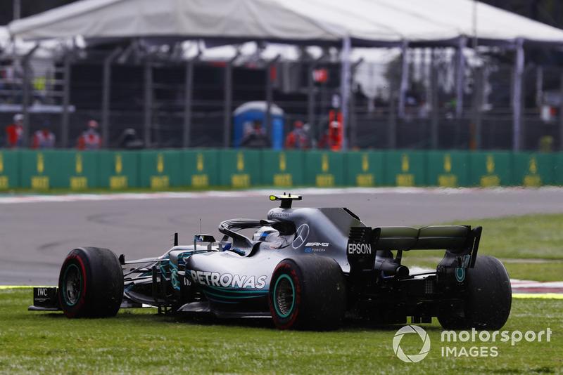 Valtteri Bottas, Mercedes AMG F1 W09 EQ Power+, heads across the grass