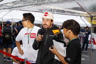 Fernando Alonso, McLaren, talks to the fans