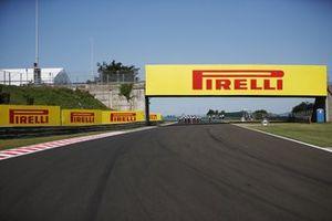 Pirelli advertising branding on a bridge and trackside