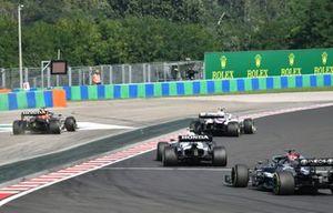 Max Verstappen, Red Bull Racing RB16B, runs wide as he battles with Mick Schumacher, Haas VF-21