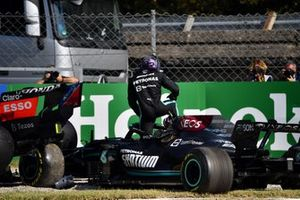Lewis Hamilton, Mercedes W12, climbs out of his car after crashing with Max Verstappen, Red Bull Racing RB16B