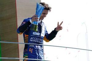 Lando Norris, McLaren, 2nd position, celebrates on the podium