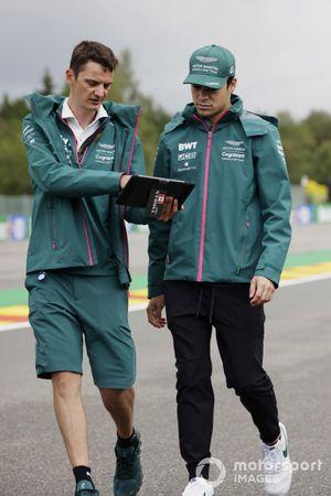 Lance Stroll, Aston Martin, talks with an engineer on the track walk