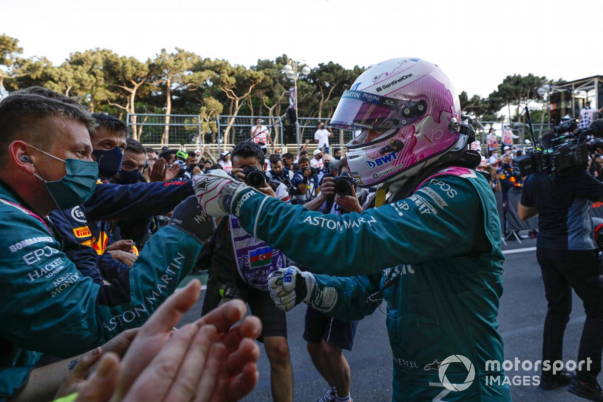 Sebastian Vettel, Aston Martin, 2nd place, celebrates with his team his arrival at Parc Ferme