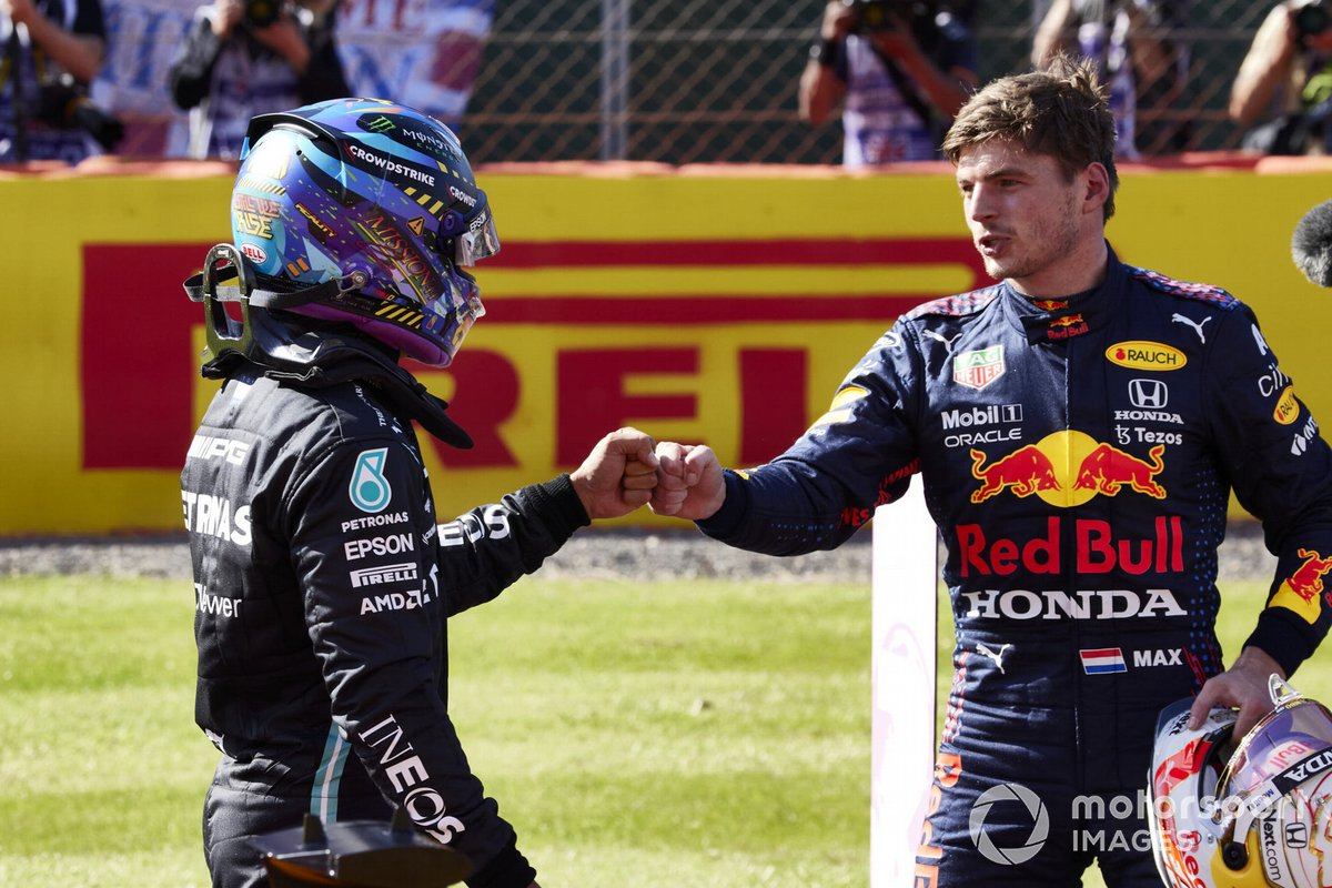 Lewis Hamilton, Mercedes, 2nd position, and Max Verstappen, Red Bull Racing, 1st position, congratulate each other