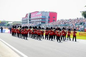The Scots Guards band of the British Army perform on the grid