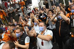 The McLaren team gathers for the podium ceremony