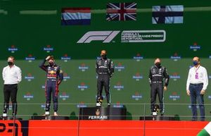 Max Verstappen, Red Bull Racing, 2nd position, Lewis Hamilton, Mercedes, 1st position, and Valtteri Bottas, Mercedes, 3rd position, on the podium