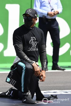Lewis Hamilton, Mercedes, and the other drivers stand and kneel in support of the We Race As One campaign