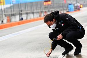 A Mercedes Benz EQ engineer checks the track temperature