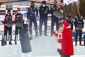 Podium: Winners Ott Tänak, Martin Järveoja, Hyundai Motorsport Hyundai i20 Coupe WRC, second place Kalle Rovanperä, Jonne Halttunen, Toyota Gazoo Racing WRT Toyota Yaris WRC, third place Thierry Neuville, Martijn Wydaeghe, Hyundai Motorsport Hyundai i20 Coupe WRC