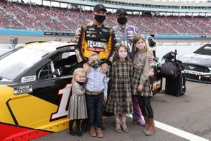 Jimmie Johnson, Hendrick Motorsports, Chevrolet Camaro, and Clint Bowyer, Stewart-Haas Racing, Ford Mustang pose with their children Cash Bowyer, Presley Bowyer, Lydia Norriss Johnson, and Genevieve Johnson prior to the race
