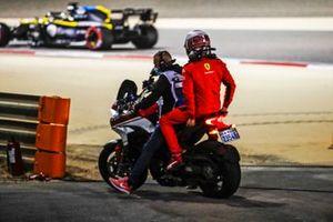 Charles Leclerc, Ferrari, gets a lift after retiring