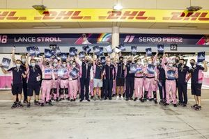 Sergio Perez, Racing Point, Lance Stroll, Racing Point, and Otmar Szafnauer, Team Principal and CEO, Racing Point gather with the rest of the team outside the garage