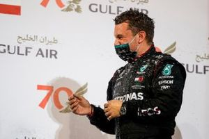 The Mercedes trophy delegate is soaked in Champagne on the podium