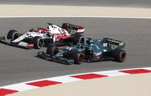 Lance Stroll, Aston Martin AMR21, side by side with Kimi Raikkonen, Alfa Romeo Racing C41